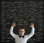 Education rocks boy dressed as business man with chalk questions — Stock Photo