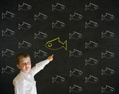 Pointing boy dressed as business man with independent thinking chalk fish — Stock Photo
