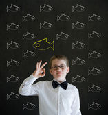 All ok boy dressed as business man with independent thinking chalk fish — Stock Photo