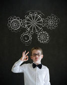 All ok boy dressed as business man with chalk turning gear cogs or gears — Stock Photo