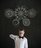 Thumbs down boy dressed as business man with chalk turning gear cogs or gears — Stock Photo