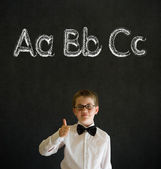 Thumbs up boy business man with learn English language alphabet — Stock Photo