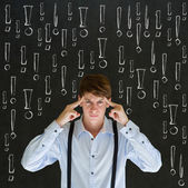 Thinking business man with chalk exclamation marks — Stock Photo