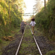Retro young love couple vintage train tracks — Stock Photo