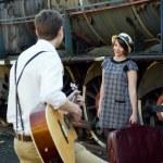 Retro young love couple vintage serenade train setting — Stock Photo #27219775