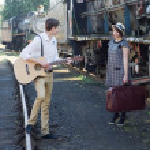 Retro young love couple vintage serenade train setting — Stock Photo #27219797