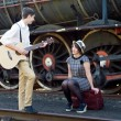 Retro young love couple vintage serenade train setting — Stock Photo #27219809