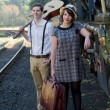 Retro young love couple vintage train setting — Stock Photo #27219815