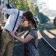 Retro young love couple vintage train setting — Stock Photo #27219879