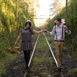 Retro young love couple vintage train tracks — Stock Photo #27219923