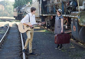Retro young love couple vintage serenade train setting — Stok fotoğraf