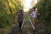 Retro young love couple vintage train tracks — Stock Photo