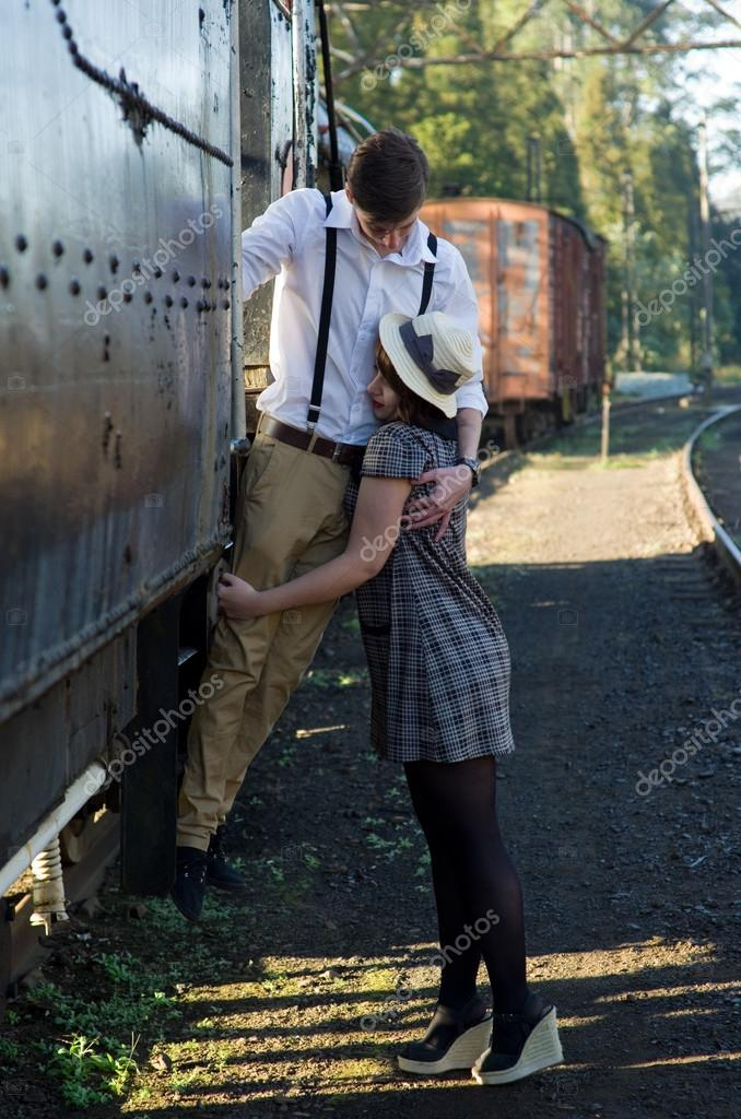Retro young love couple vintage train setting — Stock Photo ...