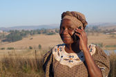 Traditional African Zulu woman speaking on mobile phone — Stock Photo