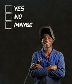 African black man industrial worker with checklist on blackboard — Stock Photo