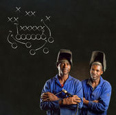 African black man industrial worker with chalk game plan blackboard — Stock Photo