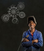 African black man industrial worker with chalk gears blackboard — Stock Photo
