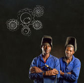 African black men industrial workers with chalk hamster gears blackboard — Stock Photo