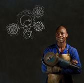 African black man industrial worker with chalk hamster gears blackboard — Stock Photo