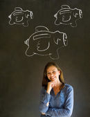 Businesswoman, student or teacher with chalk piggy banks concept — Stock Photo