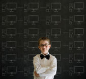 Arms crossed boy with chalk networks on blackboard background — Stock Photo