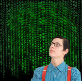 Nerd geek businessman student teacher with binary on background — Stock Photo