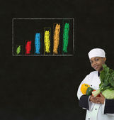 African woman chef with chalk bar graph on blackboard background — Foto Stock