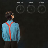 Nerd geek businessman time difference blackboard background — Stock Photo