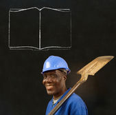 African black man worker with chalk open book on a background — Stock Photo