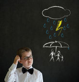 Thinking boy business man thinking about protecting family from natural disaster on blackboard background — Stock Photo