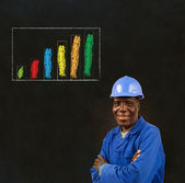 African American black man worker with chalk bar graph on a blackboard background — Stock Photo