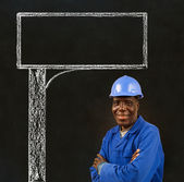African American black man worker with a chalk road advertising sign — Stock Photo