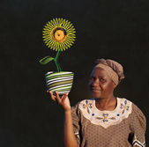 South African Zulu woman basket sales woman blackboard sunflower — Stock Photo
