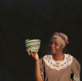 Traditional South African Zulu woman basket sales woman on blackboard background — Stock Photo