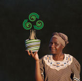 South African Zulu woman basket sales woman blackboard recycle tree — Stock Photo