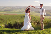 African bride and groom landscape — Stock Photo