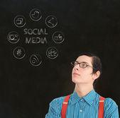 Nerd geek zakenman met social media iconen — Stockfoto