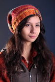 Pretty girl in a checkered shirt and a hat — Stock Photo