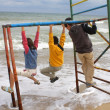 Child group playing on beach — Stock Photo
