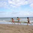 Stock Photo: Happy child group playing on beach