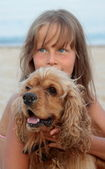 Girl with her dog on the beach — Stock Photo