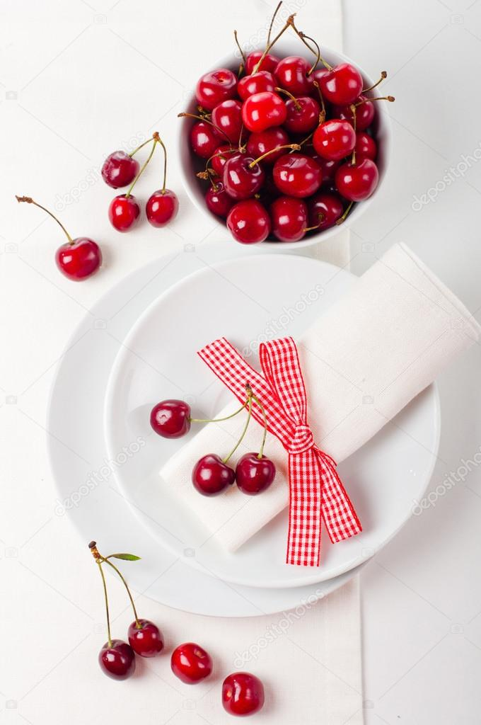 Festive table setting and decoration with fresh flowers and sweet cherry  Stock Photo #17644881