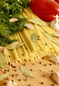 Uncooked pasta, and vegetables. — Stock Photo
