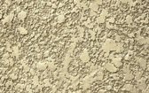 Wall covered with plaster relief. — Stock Photo