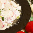 Radish salad with mayonnaise. - Stock Photo