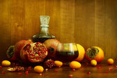 Persimmon, pomegranate and citrus fruits — Stock Photo