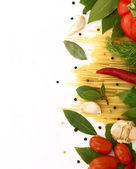 Uncooked pasta with vegetables and spices — Stock Photo