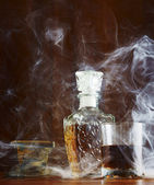 Eau-de-vie in the smoke cigars — Stock Photo