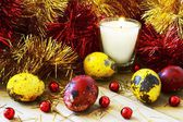 Tinsel and Easter eggs by candlelight — Stock Photo