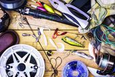 Fishing gear on the table as a frame — Stock Photo